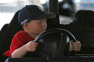 Christopher going for a spin in the bumper cars at the 2006 Ventura County Fair