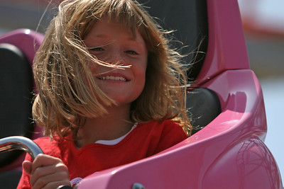 Sydney riding the Pole Position Spinning Coaster at the 2006 Ventura County Fair