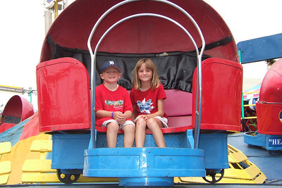 Christopher and Sydney enjoying one of the carnival rides at the 2006 Ventura County Fair.