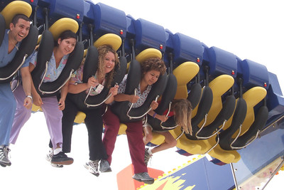 Sydney trying one of the big kids' rides at the 2006 Ventura County Fair.
