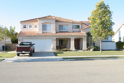 2611 Woodside Place, Oxnard CA. 4 Bedroom, 2.5 Bath, 2,193  sq.ft. (not including hobby room in garage). Lot Size is 8,803 sq.ft. This spacious home is situated on a quiet street, across from a beautiful park with a playground. Laminated wood floors, throughout the 1st floor, give the house a custom feel. The granite counter- & island top carries the custom touch into the kitchen. The appliances are stainless. There is an elaborate sound system with speakers in nearly every room. Reflecting owner pride, the home is being improved constantly. In fact, the master bathroom has just been completely redone with the finest materials. With a large lot, over 8,800-S.F., the back & side yards have a concealed RV parking with electric hookup, a combination playhouse/tool shed and a large outdoor patio. The flower beds are on a timed watering system. The front yard has plenty of curb appeal. The 3rd car space in the garage was converted and permitted into a convenient office/hobby/play space with double doors to the back yard.