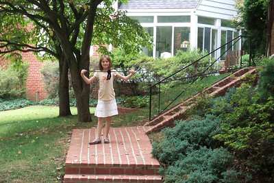 Sydney on the front steps of the rental house at 2916 N Stafford St, Arlington, Virginia. The approx. 1,300-square foot house has four bedrooms (three up, one down), 2 baths (one up, one down), a one-car garage and a 9- by 15-ft sun room (not included in square footage). (Image taken with FinePix F10 at ISO 800, f5.0, 1/125 sec and 24mm)