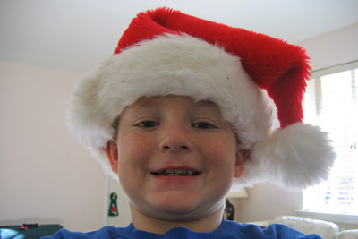 Christopher taking a self portrait to get in the Christmas spirit. (Image taken with Canon PowerShot A95 at ISO 0, f2.8, 1/50 sec and 7.8mm)