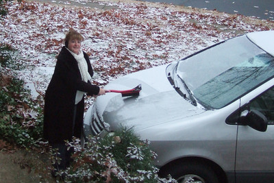 Kathy clearing the first snow from her windows before taking the kids to school. (Image taken with FinePix F10 at ISO 800, f3.4, 1/150 sec and 12.2mm)