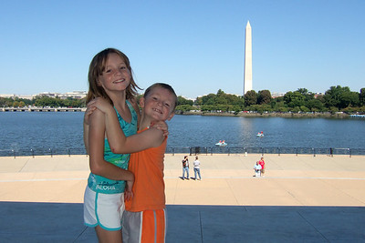 Sydney and Christopher aren't hugging each other, they're trying to hold the other flat footed as they've developed the habit of standing on their tip toes to look taller in the pictures! The Kane family enjoyed a bicycle ride from Theodore Roosevelt Island into Washington DC and through the monuments. (Image taken with FinePix F10 at ISO 200, f6.4, 1/640 sec and 8mm)
