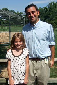 Sydney and her 4th grade teacher, Mr. Ferrara. (Image taken with FinePix F10 at ISO 80, f5.6, 1/550 sec and 8mm)