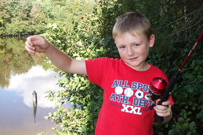 Christopher finally catches a small perch at Lake Anna State Park. Though it was small, he was happy to catch it. (Image taken with FinePix F10 at ISO 200, f4.0, 1/340 sec and 8mm)