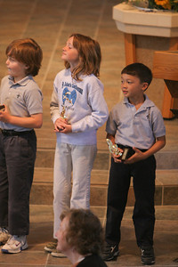 Kids getting their music trophies during chapel at St. John's Lutheran School. (Image taken with Canon EOS 20D at ISO 800, f2.8, 1/100 sec and 200mm)