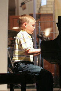 Music Recital. (Image taken with Canon EOS 20D at ISO 800, f2.8, 1/60 sec and 70mm)