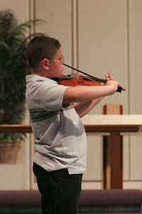 Music Recital. (Image taken with Canon EOS 20D at ISO 800, f2.8, 1/125 sec and 70mm)