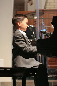 Music Recital. (Image taken with Canon EOS 20D at ISO 800, f2.8, 1/50 sec and 70mm)