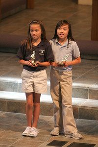 Kids getting their music trophies during chapel at St. John's Lutheran School. (Image taken with Canon EOS 20D at ISO 800, f2.8, 1/125 sec and 200mm)