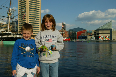 Christopher and Sydney enjoying a stroll around Baltimore's Inner Harbor after a day trip to the National Aquarium in Baltimore. (Image taken with Canon EOS-1DS at ISO 400, f14.0, 1/800 sec and 32mm)