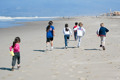 The kids running along the beach looking for another sea lion that has washed ashore. (Image taken with Canon EOS-1D at ISO 200, f2.8, 1/5000 sec and 78mm)