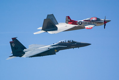 P-51, F-22 and F-15E Eagle. 2007 Point Mugu Air Show (Image taken with Canon EOS-1D at ISO 200, f4.0, 1/3200 sec and 260mm)