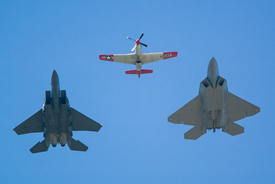 P-51, F-22 and F-15E Eagle. 2007 Point Mugu Air Show (Image taken with Canon EOS-1D at ISO 200, f4.0, 1/2500 sec and 280mm)
