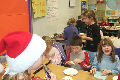 Ms. Glover's 2nd grade classroom Christmas party at Taylor Elementary. (Image taken with FinePix F10 at ISO 800, f2.8, 1/120 sec and 8mm)