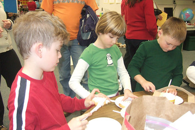 Ned Huffman, Alexandra Nemfakos and Christopher Kane. Christopher's 2nd grade classroom Christmas party at Taylor Elementary. (Image taken with FinePix F10 at ISO 800, f2.8, 1/100 sec and 8mm)