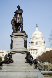 James A. Garfield monument, by sculptor John Quincy Adams Ward, on Capitol Hill at Maryland Avenue and 1st.   James A. Garfield (1831-1881) served with distinction in the Union Army during the Civil War. He left the army on his election to the U.S. House of Representatives in 1863. He was later nominated as the Republican candidate for the Presidency in 1880 and won (by only 10,000 votes) over Civil War General Winfield Scott Hancock. He had to resign his position as a member of the House, to which he had been re-elected in the same election.   Sworn into office in March 1881, he immediately began handing out government positions to supporters. An unsuccessful patronage seeker, Charles Guiteau, shot Garfield in the back in July 1881. Garfield lingered for 79 days before dying. His Vice President, Charles A. Athur (who first met Garifled after their election) was sworn in as president.   Garfield was assassinated on the grounds of the old Baltimore & Pacific Railway depot, now occupied by the East Wing of the National Gallery of Art. The site is easily seen from Garfield's statue.