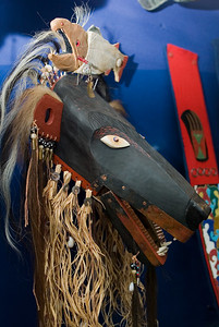 Bear Mask from the Mad River Band of Yurok, by Rick Bartow, 1990. Made from wood, paint, metal, horse hair, cotton cloth, glass beads, shell, bone and fiber. National Museum of the American Indian Catalogue # 25/4798.