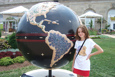 """4th of July on the National Mall. Sydney enjoying the """"Cool Globes: Hot Ideas for a Cooler Planet"""" exhibit at the U.S. Botanic Garden. The globes, designed by local, national and international artists, depict simple solutions to global warming. (Image taken with FinePix F10 at ISO 80, f4.0, 1/300 sec and 8mm)"""