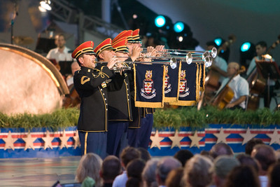"""U.S. Army Herald Trumpets.   We celebrated the 4th of July on the West Lawn of the U.S. Capitol with the Buck Thomas family enjoying PBS' A Capitol Fourth--America's biggest and best-loved 4th of July concert, which was hosted by actor Jimmy Smits. We enjoyed performances by Huey Lewis and the News, Jerry Lee Lewis and American Idol winner Taylor Hicks, then watched a spectacular fireworks display with the Washington Monument as the backdrop while the National Symphony Orchestra played Tchaikovsky's """"1812 Overture."""" (Image taken with Canon EOS 20D at ISO 800, f2.8, 1/80 sec and 200mm)"""