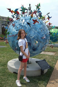"""4th of July on the National Mall. Sydney enjoying the """"Cool Globes: Hot Ideas for a Cooler Planet"""" exhibit at the U.S. Botanic Garden. The globes, designed by local, national and international artists, depict simple solutions to global warming. (Image taken with FinePix F10 at ISO 80, f5.0, 1/480 sec and 8mm)"""