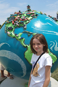 """4th of July on the National Mall. Sydney enjoying the """"Cool Globes: Hot Ideas for a Cooler Planet"""" exhibit at the U.S. Botanic Garden. The globes, designed by local, national and international artists, depict simple solutions to global warming. (Image taken with FinePix F10 at ISO 80, f5.0, 1/600 sec and 8mm)"""