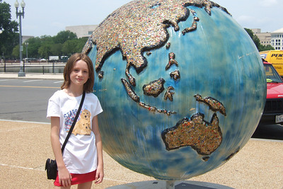 """4th of July on the National Mall. Sydney enjoying the """"Cool Globes: Hot Ideas for a Cooler Planet"""" exhibit at the U.S. Botanic Garden. The globes, designed by local, national and international artists, depict simple solutions to global warming. (Image taken with FinePix F10 at ISO 80, f5.6, 1/400 sec and 12.2mm)"""