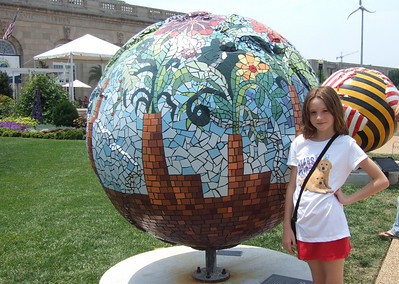 """4th of July on the National Mall. Sydney enjoying the """"Cool Globes: Hot Ideas for a Cooler Planet"""" exhibit at the U.S. Botanic Garden. The globes, designed by local, national and international artists, depict simple solutions to global warming. (Image taken with FinePix F10 at ISO 80, f5.0, 1/419 sec and 8mm)"""