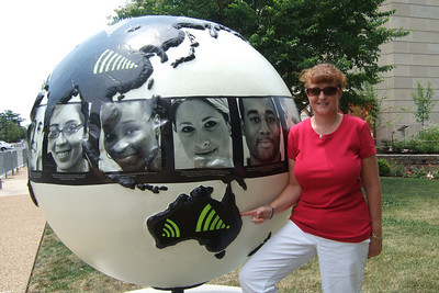 """4th of July on the National Mall. Kathy enjoying the """"Cool Globes: Hot Ideas for a Cooler Planet"""" exhibit at the U.S. Botanic Garden. The globes, designed by local, national and international artists, depict simple solutions to global warming. (Image taken with FinePix F10 at ISO 80, f4.5, 1/320 sec and 8mm)"""
