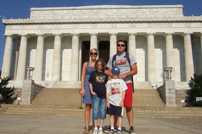 On the steps of the Lincoln Memorial. Kathy's niece, Anita, and her boyfriend, Andrew, were our first guests in our new home. They were in the States for a visit from England, so we showed them the sights of Washington D.C. (Image taken with FinePix F10 at ISO 200, f8.0, 1/950 sec and 8mm)