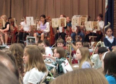 Taylor Elementary School's 2008 Spring Concert, with performances by the band and orchestra. Sydney was on the flute. (Image taken with FinePix F10 at ISO 800, f5.0, 1/15 sec and 24mm)