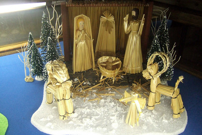 Sweden (made of straw and wood). From the Sommer Collection at the Washington National Cathedral. The stable of this crèche is a simple lean-to with wooden sides, the top and back covered with lashed straw. Mary's free-standing mantle completely encloses her figure, while the Star of Bethlehem is supported by its own rays. Annual Crèche Exhibit (nativity scenes) at the Washington National Cathedral. (Image taken with FinePix F10 at ISO 800, f2.8, 1/30 sec and 8mm)