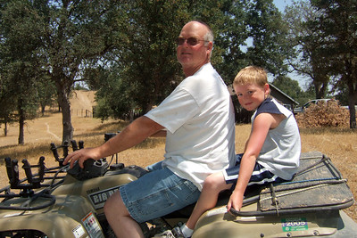 Frank and Christopher on the four wheeler to follow the girls to the arena.   We visited the Roth family our first weekend in California. The kids had a great time, especially on Sunday when Aunt Betsy and Uncle Frank took them for rides on the horses and four wheeler. (Image taken with FinePix F10 at ISO 200, f6.4, 1/640 sec and 8mm)