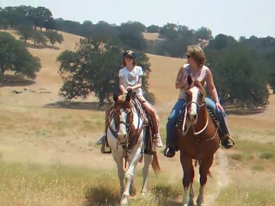 Aunt Betsy and Sydney riding their horses from the Roth house to the arena on the Martinez ranch.  We visited the Roth family our first weekend in California. The kids had a great time, especially on Sunday when Aunt Betsy and Uncle Frank took them for rides on the horses and four wheeler.
