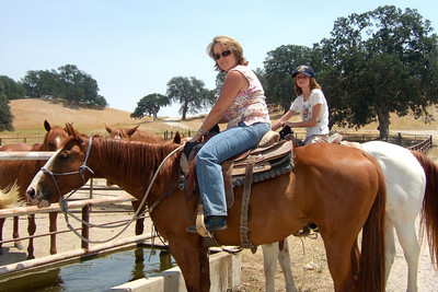 Aunt Betsy and Sydney watering their horses outside the arena.   We visited the Roth family our first weekend in California. The kids had a great time, especially on Sunday when Aunt Betsy and Uncle Frank took them for rides on the horses and four wheeler. (Image taken with FinePix F10 at ISO 200, f5.6, 1/600 sec and 8.9mm)