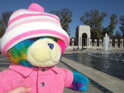 Rainbow Bear at the National World War II Memorial. The bear belongs to Kathy's pre-school class and gets to go home with the students and teacher over the weekends. (Image taken with FinePix F10 at ISO 200, f8.0, 1/1000 sec and 8mm)