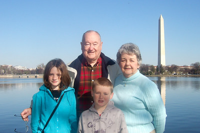 Grady and Mary Clare in front of the Washington Monument with their grandchildren Sydney and Christopher. (Image taken with FinePix F10 at ISO 200, f6.4, 1/680 sec and 10.4mm)