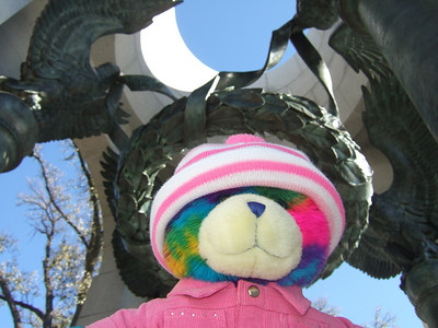 Rainbow Bear at the National World War II Memorial. The bear belongs to Kathy's pre-school class and gets to go home with the students and teacher over the weekends. (Image taken with FinePix F10 at ISO 200, f4.5, 1/450 sec and 8mm)