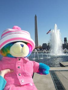 Rainbow Bear at the National World War II Memorial. The bear belongs to Kathy's pre-school class and gets to go home with the students and teacher over the weekends. (Image taken with FinePix F10 at ISO 200, f7.1, 1/800 sec and 8mm)