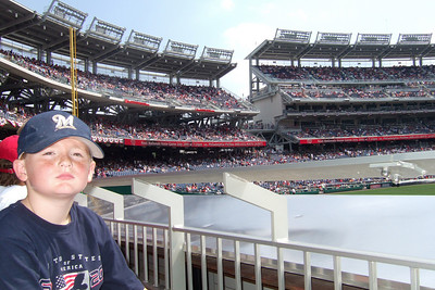 We enjoyed a hot Sunday afternoon watching the Astros shut out the Washington Nationals 5 to 0. Though we had excellent, front row, center field seats, Sydney wanted shade instead. Just as well as the boys were rooting for the team from Texas while the girls rooted for the home team. Unfortunately for them, it was the Astro's Brandon Backe who stole the show by pitching seven-plus innings, and going 2-for-3 with a double and scoring twice. (Image taken with FinePix F10 at ISO 200, f5.6, 1/750 sec and 8mm)