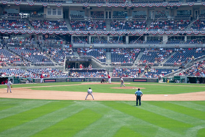 We enjoyed a hot Sunday afternoon watching the Astros shut out the Washington Nationals 5 to 0. Though we had excellent, front row, center field seats, Sydney wanted shade instead. Just as well as the boys were rooting for the team from Texas while the girls rooted for the home team. Unfortunately for them, it was the Astro's Brandon Backe who stole the show by pitching seven-plus innings, and going 2-for-3 with a double and scoring twice. (Image taken with FinePix F10 at ISO 200, f5.0, 1/480 sec and 24mm)