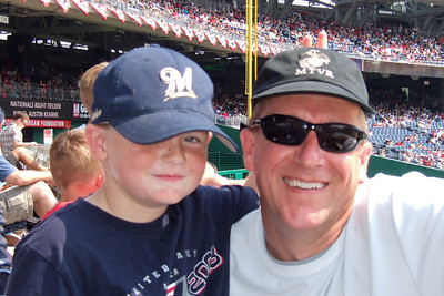 We enjoyed a hot Sunday afternoon watching the Astros shut out the Washington Nationals 5 to 0. Though we had excellent, front row, center field seats, Sydney wanted shade instead. Just as well as the boys were rooting for the team from Texas while the girls rooted for the home team. Unfortunately for them, it was the Astro's Brandon Backe who stole the show by pitching seven-plus innings, and going 2-for-3 with a double and scoring twice. (Image taken with FinePix F10 at ISO 200, f5.6, 1/320 sec and 16.1mm)