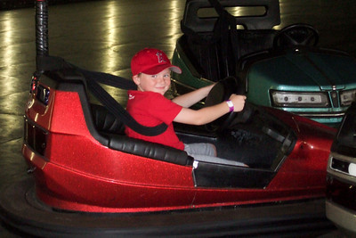 Christopher enjoying bumper cars at Kings Dominion. (21 Jun 2008) (Image taken with FinePix F10 at ISO 800, f5.0, 1/100 sec and 24mm)