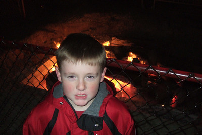 Christopher enjoying the heat from the Yule Log at The Ellipse. (Image taken with FinePix F10 at ISO 800, f2.8, 1/100 sec and 8mm)