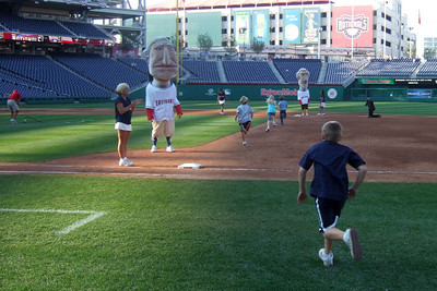"""Christopher heading onto the field for """"Kids Run the Bases"""" at Nationals Park. (Image taken with FinePix F10 at ISO 200, f4.0, 1/340 sec and 8mm)"""