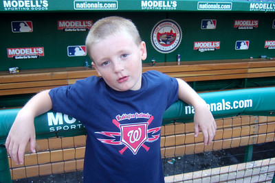 Christopher next to the visitor's dugout in Nationals Park. (Image taken with FinePix F10 at ISO 200, f2.8, 1/120 sec and 8mm)