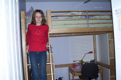 Sydney showing off her loft bed. (Image taken with KODAK EASYSHARE C653 ZOOM DIGITAL CAMERA at ISO 80, f2.7, 1/60 sec and 6mm)