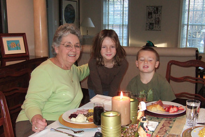 Mary Clare and her grandkids, Sydney and Christopher, enjoying Thanksgiving dinner (27 Nov 2008) (Image taken with FinePix F10 at ISO 800, f2.8, 1/100 sec and 8mm)